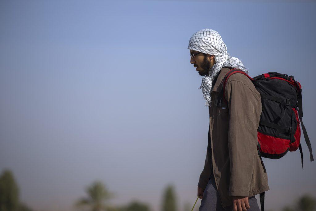 Guy wearing keffiyeh
