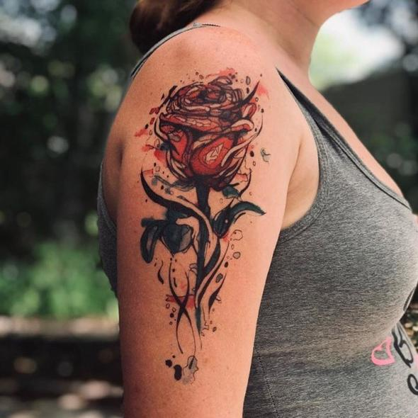 woman with a rose tattoo