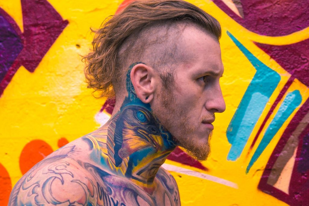 man with neck tattoos