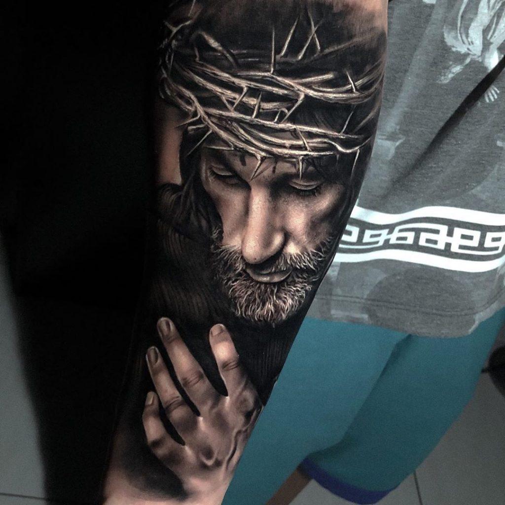 Arm tattoo of Jesus