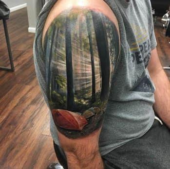shoulder tattoo of a landscape